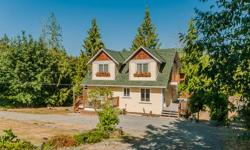 # Bath 4 Sq Ft 2352 MLS # Bed 3 Privacy and tranquility with a 3 story home on a private, level 1 acre lot 5 minutes from the city and 5 minutes from Nanaimo Airport or Duke Point ferry. Rarely does an opportunity like this arise! This well maintained
