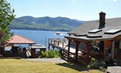 # Bath 3 Sq Ft 2491 MLS 415016 # Bed 4 Sun Soaked, Lake front property with mountain views, private beach, covered hot tub, cabana & wet bar, and all within minutes to Duncan. This home offers 2,491 sq. ft. surrounded by large decks, patios and porches.