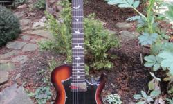 Paul Reed Smith Starla S2 electricc guitar. Made in USA, excellent condition. Tobacco-sunburst colour, Bibsby tailpiece/tremelo. Comes in PRS robust gigbag. I am selling this guitar because I am primarily an acoustic musician and it's just not getting the