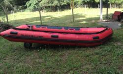 14' inflatable heavy duty boat complete with heavy duty rowing frame, Carlisle oars and brass oar locks, wheels for easier moving on land. Boat has been used once for a hunting trip then dry stored, in new condition. New price without rowing frame, wheels