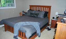 Queen sized bed & 2 night tables for sale. Headboard, footboard & side rails. (Mattress not for sale).