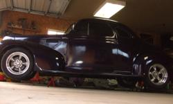 39 dodge hot rod ...350 chev with mild cam ,high rise intake ,headers,  4 speed standard...17inch rear 16 inch front american racing rims on new rubber..custom exhaust ..custom interior...painless wiring harness...ididit steering coloum...gm front frame