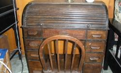 rare antique childs rolltop desk. oak with chair. Very pretty. Approx. circa 1900. Have receipt of purchase for $650 in 1992. Priced for quick sale $550.