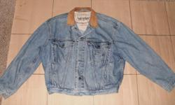 Classic stone washed original Levi jean jacket with real leather collar. Almost impossible to find. Size L- XL (42-44+chest). front chest pockets and side hand pockets. Excellent condition
