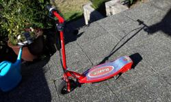 A red Razor E100 Electric scooter. Not used a lot,still in great shape $75