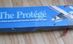 one in the box $150.00, part of wing built then lost interest. look online at protege airplane to see what you are buying , for os60 engine