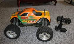 CEN Genesis GST 7.7cc nitro monster truck. Has 3-Speed Automatic Transmission with Reverse. Original owner, like new, only 5 tanks of fuel ever used. Excellent condition, works perfectly, complete and ready to run with all accessories.