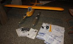 Carl Goldberg Anniversary Edition J-3 Piper Cub R/C airplane finished in cub yellow and full wingspan (not 'clipped')- mostly complete - finishing touches and radio instal are still required to finish. Carl Goldberg matching floats included as shown in