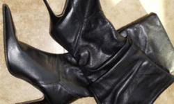 Made in Italy, bought in Rome. European size 39, roughly size 7.5/8. Slouchy look, knee high boots. Real leather. Paid much more. Beautiful boots, pointy toe.