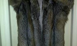 """This beautiful sleeveless women's wolf fur coat was given to me by my aunt. It was converted for her by Speiser Furs from a full length men's coat. There is an inside pocket on the right hand side that has my aunt's initials """"ERG"""" stitched into the"""