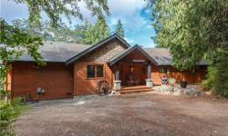 # Bath 3 Sq Ft 2878 # Bed 3 Private sanctuary, estate property 1.3 acres with executive 3 bed, 3 bath, custom designed level entry home and two double garages for the car enthusiast . This 1997 3200 sq ft home features solid wood cabinetry, doors, and