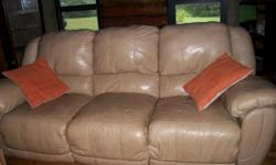 mostly leather has vinyl on the side and back. light tan in color. both ends recline the left side with no problem the right one sticks sometimes and u need to jiggle the handle. otherwise in like new condition. very comfy for sitting and snuggling.very
