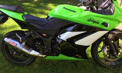Upgrades includes Oshimira full exhaust system and K & N High flow air filter.Well maintained, paint looks brand new! Excellent condition Ninja 250R Special Edition. Brand new tires not even used yet. One owner, never dropped. Always stored in heated