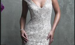 """*Photos are from the designer* The dress was bought new and never worn. I am 5'9"""" and 140lbs, usually a size 6-8. The dress fits very well and would have only needed few alterations. Manufacturer description: The sparkling Swarovski beading on this gown"""
