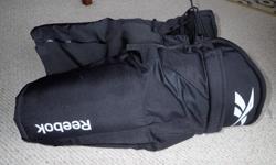 Reebok Pro Stock hockey pants, on sale at Hockey Monkey for $89 us dollars plus shipping. Pants are black, mens medium, 32-34, new.