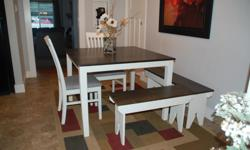 Beautifully refinished square table complete with 2 chairs and 2 benches which can be arranged to make a corner seating arrangement. The table has been painted in antique white melamine paint which is very hard wearing and the top is stained in