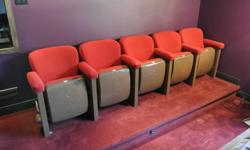 Five red classic theater seats. I was told by the previous owner that they came out of an old theater in Calgary. Good condition. The metal frames have some minor scuffing. However, all the upholstery was replaced about 8 years ago and has been lightly