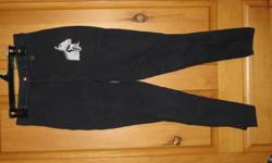 RIDING BREECHES FOR SALE SIZE 14 (VERY SMALL - MORE LIKE A 10) BLACK WITH HORSES EMBROIDERED ON THE FRONT. HARDLY USED.