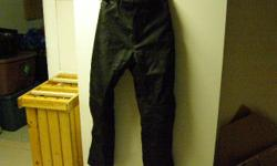 Tourmaster Quest size M overpants made of Carbolex, stronger than nylon. Waterproof, windproof but breathable, flexible removeable armor, use for motorcycle or in winter for snowmobile. Seldom used, like new.