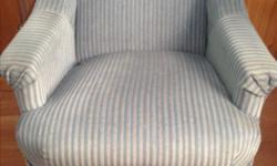 Comfortable light blue and grey crush fabric rocking chair which also swivels. Good condition. Call or text.