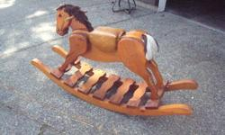 Authentic wooden Rocking Horse in good condition