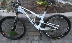 2011 Element with Carbon front triangle. The front triangle frame is 2 years old due to warranty replacement as are suspension bearings. Adjustable front travel 100-120mm, rear 100. Great fast xc race or trail bike. 2x10 drivetrain, SRAM 9 derailleur,