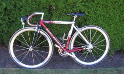 Rare custom made 47 cm seat tube aluminum frame, top tube 48 cm. Campagnolo Zonda clincher wheels and 8 speed shifting. Dura Ace cranks and brakes. Excellent condition road bike for small person. Will help size it to you.