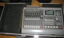 Roland VS880ex with a DJ case I butchered to work with this unit. Great little multitracker. The master volume fader is set to unity gain in software and does not move - I'm sure if you needed a master volume it would be an easy fix, but I have had no