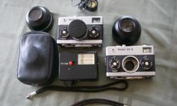 Two Rollei 35mmS cameras. ( one for parts). Comes with lens cap, two bracelets, daylight filter, two Bower lenses, wide angle and telephoto, Bower Tele-wide finder, Rollei Flash, case. All in great working order.