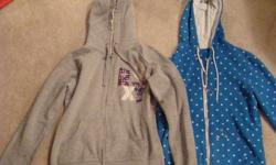I have two hoodies that I am selling. Both of them are a size medium. One is a blue polka-dot zip- up. hoodie that is from West 49. The other is a grey Roxy brand zip up hoodie. It features the roxy logo on the front.