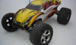 Traxxas Rustler . Has new XL5 esc lipo compatable, 12T motor and transmitter/receiver. The rest is used.  Has upgrade's such as Aluminum rear shock tower , RPM camber arms , trencher rear tires and badlands front tires. Works as it should. You will need