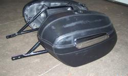 Hardcover leather looking saddlebags and mounting hardware bracket to fit a 2006 Yamaha Stratoliner 1900.Good shape asking $250 or best offer for set.