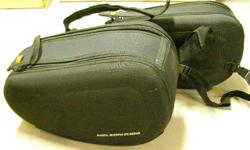 Universal fit with all straps. Very good condition, no wear or damage, made by Nelson-Rigg. Streamlined shape, semi-rigid nylon, hold shape when empty.