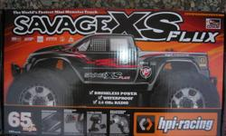 Savage flux xs mini, excellent truck all the way around ton's of power. will handle 2 and 3s lipo's . Very fast. like new . 2.4 radio. you will need battery's and charger and you are set to have alot of fun. This truck is like new. $315.00