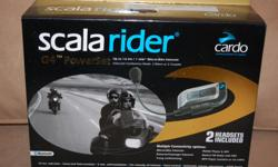 """Cardo Scala Rider """"G4 PowerSet"""" Rated #1 wireless communication system for motorcycle helmets. Bluetooth. 2-Factory Paired G4 Units in one box. Full intercom bike-to-bike. 8-10 hours radio time. Up to 1.6 Km distance. Talk time between charges up to 10"""