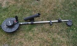 """Scotty Manual Downrigger. 60"""" long, 1 1/4"""" diameter telescoping stainless steel boom (collapses to 36"""" for storage). Includes rod holder. New condition. Has not been used."""