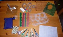Scrapbooking supplies, mostly Creative Memories.  Cutting systems, pens, stickers, paper, Memory Mates carrying case, idea books.  $75 for everything.  From a smoke free/pet free home.  Excellent condition.