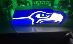 Back to school & ready for the NFL season? This custom made authentic Seahawks sign/light is perfect for any living room / man cave or bar. Lights up in dark and looks awesome with green background light for perfect ambience. Please email. Also have a
