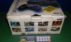 Item: This Sega Saturn comes complete in box. Included is some paperwork, cords, console and one controller. Packaging is inside the box but the outside box condition is worn as seen in the photo. All games & consoles come with a one month warranty.