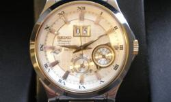"""3 years Old. In storage for last year SNP004P1 Kinetic Perpetual Calendar, which means it keeps track of months and even leap year. Kinetic means no battery change ever, can """"sleep"""" for as long as 4 years and come back at correct time, date and year."""