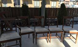Set of 5 wooden chairs for a dining room table, with padded seats, including a captain's chair. One chair needs some repairs.