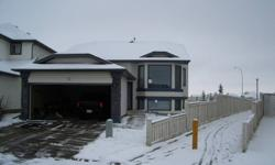 Large 3 bedroom house to share with one other clean non-smoking person in NW Calgary.Available Feb.01 2012.Rent includes utilitys,cable,unlimited internet,seperate bathroom, partially furnished bedroom, laundry facilitys,half of two car garage, large deck