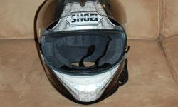 Top quality SHOIE Full Face helmet with visor. Beautiful design. Air vents, great padding inside and on chin piece. In excellent condition. Never dropped. Stored in original bag. Worn less than three months. Grey and black with 'puzzle pieces' design.