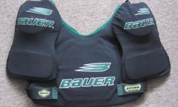 BAUER SHOULDER PADS, BLACK IN COLOR, MODEL SP300 SIZE MEDIUM, IN GREAT CONDITION, DELIVERY CAN BE ARRANGED.