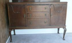 Sideboard made in Scotland. Solid wood, good condition, 3 drawers (dovetail joints), one shelf on each side. Not sure how old, but the furniture maker was in business from 1868 to 1990. Can be viewed near Salmon Arm.