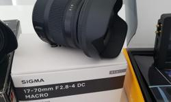 Sigma 17-70mm f/2.8-4 DC Macro OS HSM (Canon mount) - New condition with original box . http://www.dpreview.com/reviews/sigma-17-70mm-f2-8-4-os-hsm