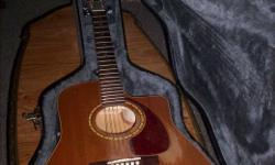 Nice cedar acoustic/Electric, B-band pickup sounds amazing. Sounds great unplugged too. Comes with nice Hard shell case. Some wear as seen in photos and battery door latch is gone so taped shut. $340 O.B.O.