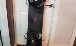 Sims Snowboard, wide, 164, with full wood core in good condition. Boot Size 11.5, white and in great condition.