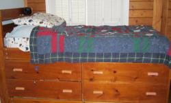 single captain's bed, mattress included; pull out bed on bottom, mattress included on pull out as well; 4 large drawers for storing clothes, etc; 2 handy shelves in headboard for clock, books, etc; great bed!