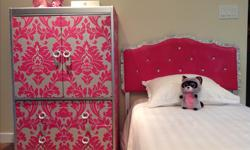 """Beautiful bedroom set in pink, silver and rhinestones. Wardrobe has two bottom drawers and a shelf in the body. In great condition. Perfect for your little princess. Headboard is 38"""" w X 38"""" h. Wardrobe is 30""""w X 45 1/2"""" h X 16""""w."""